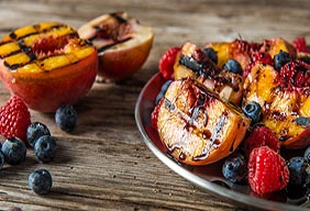 Grilled Stone Fruit with Berries & Cream