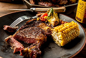 Grilled Coffee Rubbed Ribeye with Charred Corn & Tomato Salad