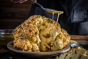 Whole Roasted Cauliflower with Garlic Parmesan Butter